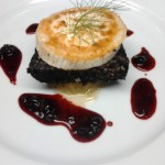 Black pudding and goats cheese with caramelised onions & mixed berry compte